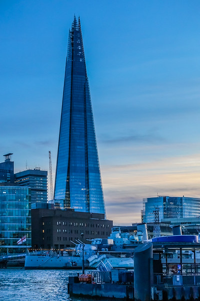 """The Shard, also referred to as the Shard of Glass, is a 95-story skyscraper in Southwark, London, that forms part of the London Bridge Quarter development. Standing 309.7 metres (1,016 ft) high, the Shard is the tallest building in the United Kingdom. (<a href=""""https://en.wikipedia.org/wiki/The_Shard"""">Wikipedia</a>)  Additionally, the Shard makes for another great photographic subject given its stature and reflective surfaces."""