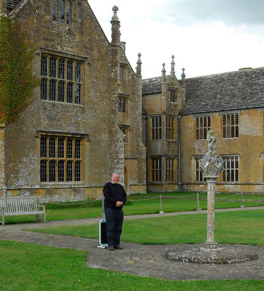 Rare shot of ancient wreck standing in front of better preserved building at Mottisfont.