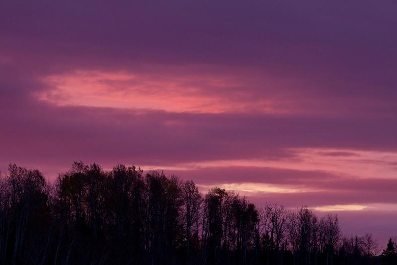 Sunrise from Highway 11 bridge over the Englehart River in Englehart, Ontario.