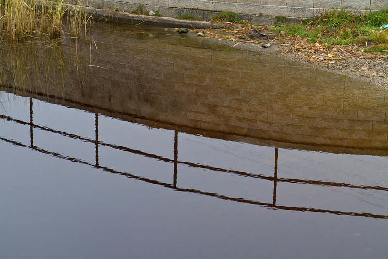 Reflection of railing at boat launch