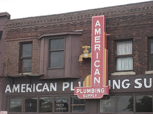 American Plumbing Supply<br /> East Grand Avenue<br /> Sign removed August, 2010