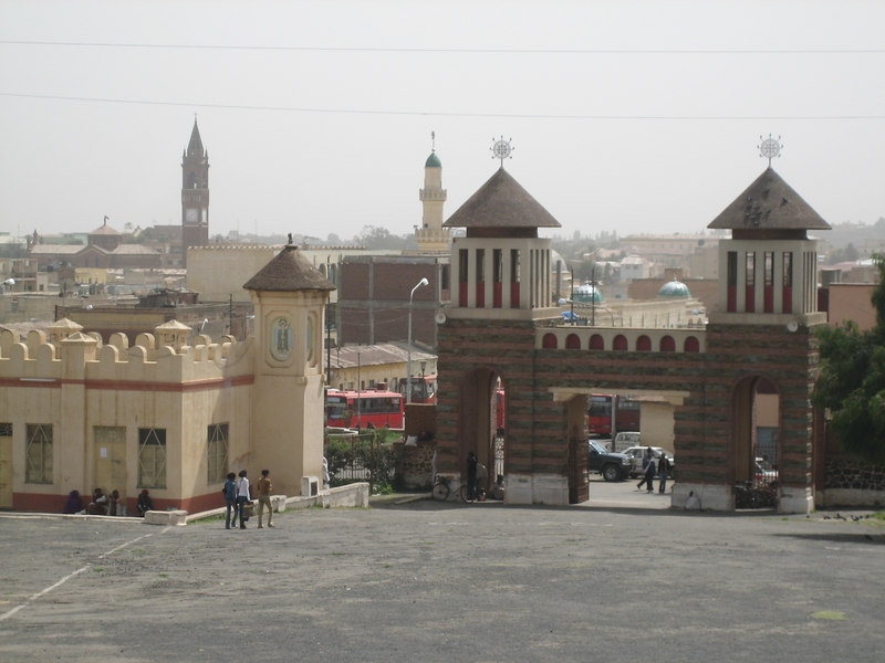 This is a classic Asmara photo, one can see a Catholic Cathedral (left), a Mosque (middle) and an Orthodox Christian Church (right).  These are the three dominant religions, and there is relatively little religious strife.