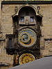 Astronomical clock (Orloj) in Old Town Square. Disciples show themselves in the two doors at the top every hour. Then the skeleton of death (right side of face at 2 o'clock) tolls the hour.