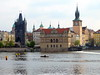 Black tower is at end of Charles bridge; more modern building alongside