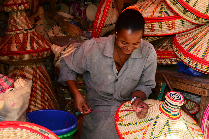 Woman weaving a 'mesob' - basket in which Ethiopian meals are served