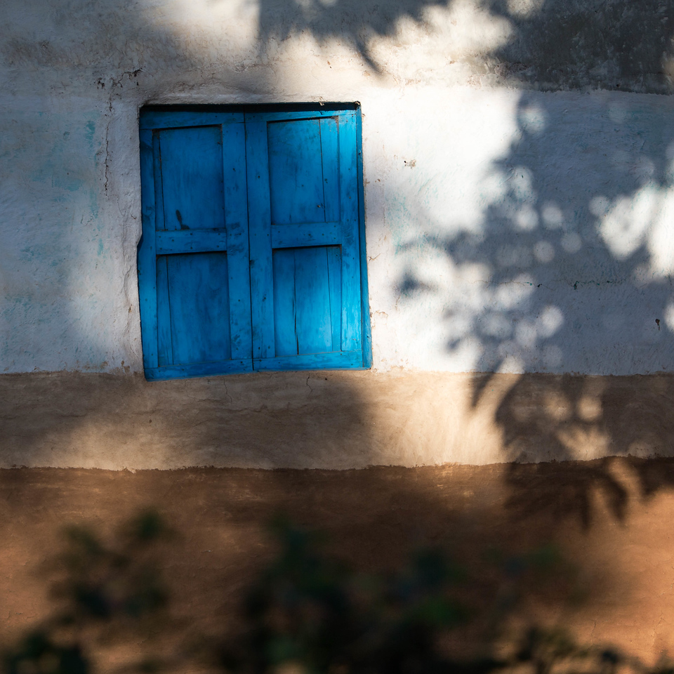 The blue window shutter on mud house of Jinka (Omo Valley, Ethiopia)