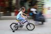 Small biker, but pedaling hard!
