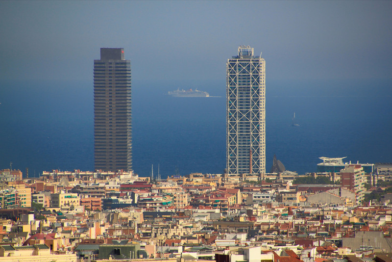 Cruise Ship between two Towers in Barcelona