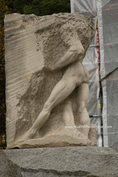 "The male figure merging with the rock  represents ""Orpheus entering Hades"" and is a representation of the air raid victims and all of those who sacrificed their lives in resistance against National Socialism."