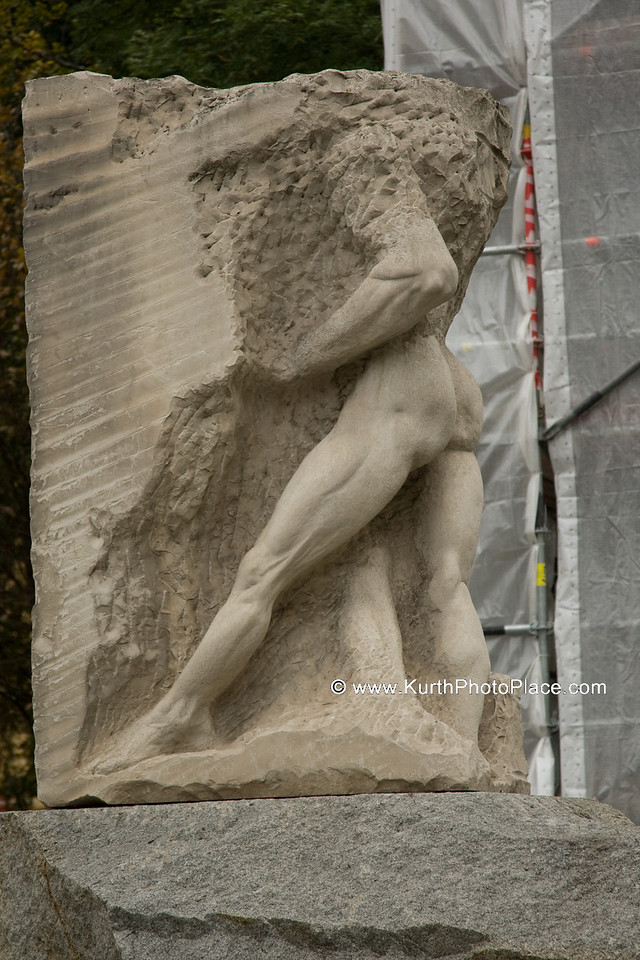 """The male figure merging with the rock  represents """"Orpheus entering Hades"""" and is a representation of the air raid victims and all of those who sacrificed their lives in resistance against National Socialism."""