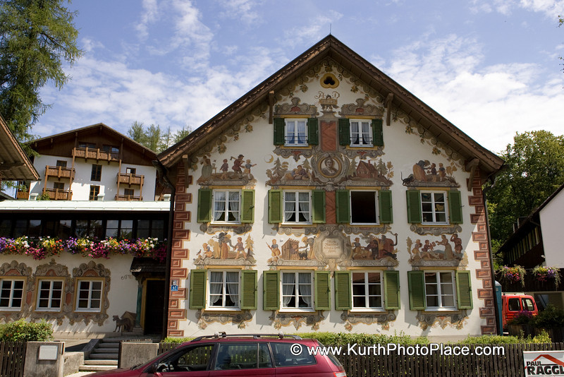 "This fresco has scenes from the story Hansel and Gretel. This particular house is the Marie-Mattfeld Hansel und Gretel-Heim on Ettalerstrasse in Oberammergau. Its name comes from generous contributions of opera singer Marie Mattfels. The home is for children and teens with family emergencies. It is run by the city of Munich and has been known as the ""Hansel und Grete-Heim"" since 1922. . Themes are often from German folklore or from the Bible. Franz Zwinck (1748-1792) popularized this style of painting in Bavaria. The style is influenced by the Italians. It was popular in this part of Bavaria in the 18th century."