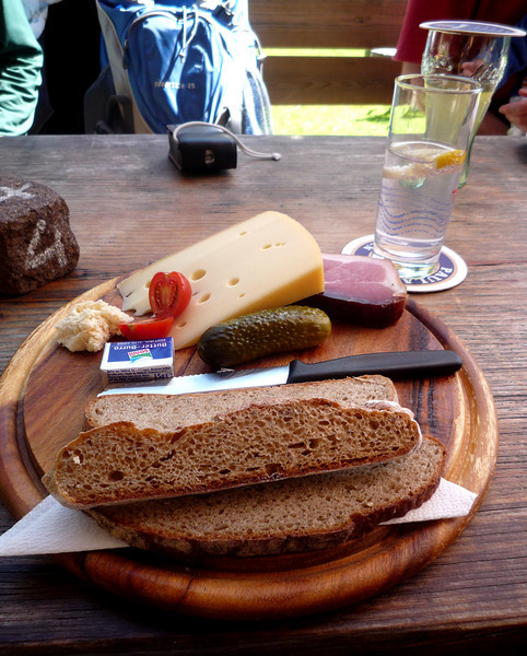 And this is ham and cheese board comprised of local smoked ham, local cheese and bread, with some fresh horseradish and a pickle.