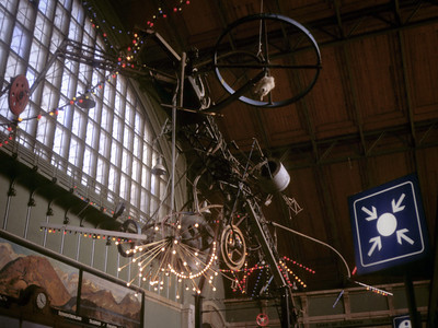 Treffpunkt (meeting place) -- ours was in Bern, the image is from Basel; same circle-and-arrows sign in every train station and airport throughout Europe. Weird sculpture by Basel native Jean Tinguley.