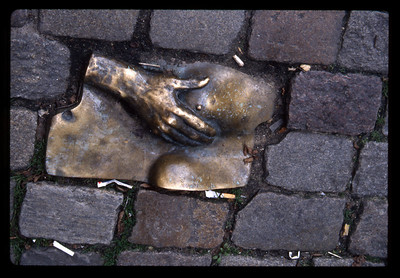 Amsterdam sculpture in cobblestones.