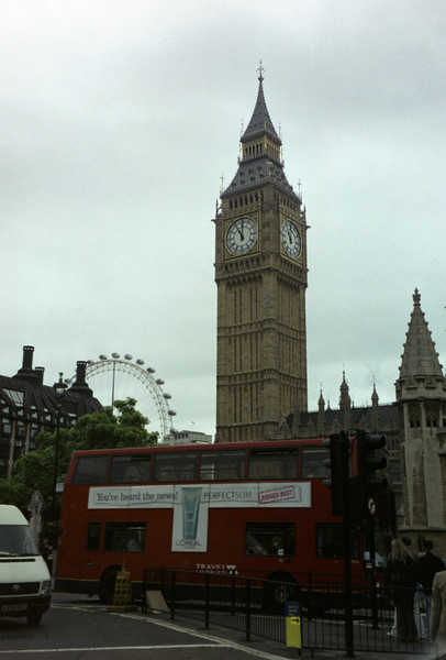 Big Ben behind a red bus.