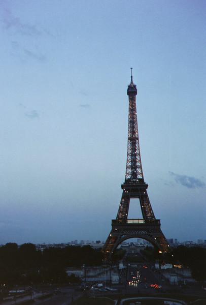 The Eiffel Tower, flashing at night.