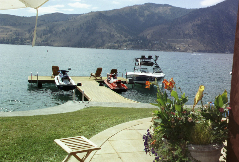The dock and boats in front of the Murrays' house at lake Chelan.