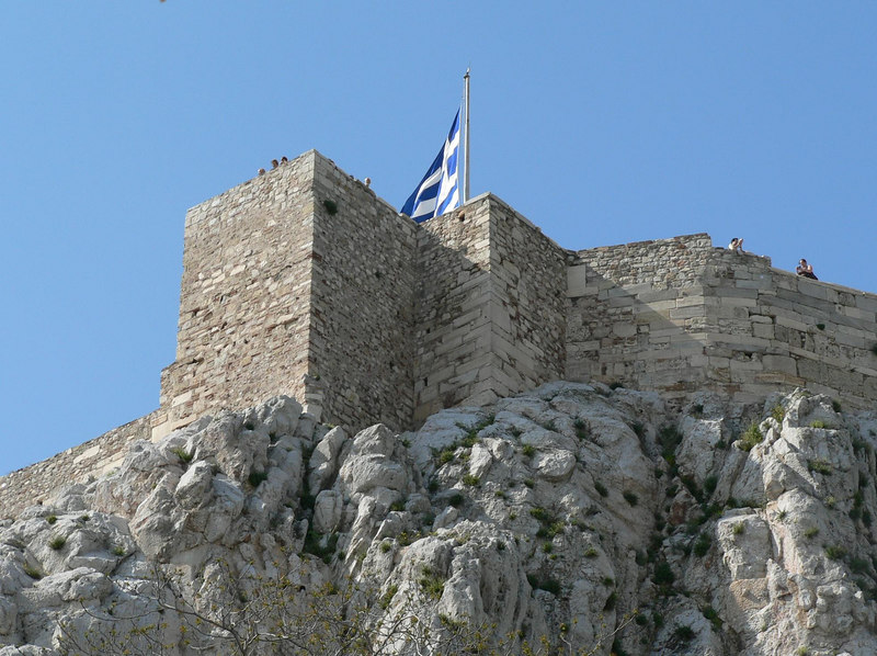 The Greek flag flying over the Acropolis, Athens