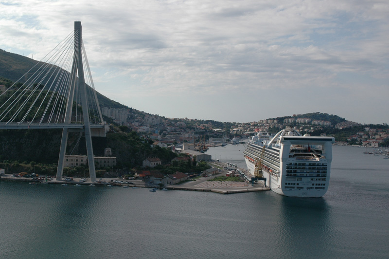 Grand Princess docked next to the Dubrovnik cable-stay bridge.