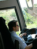 Our driver, Spiros, at the wheel of our purple bus