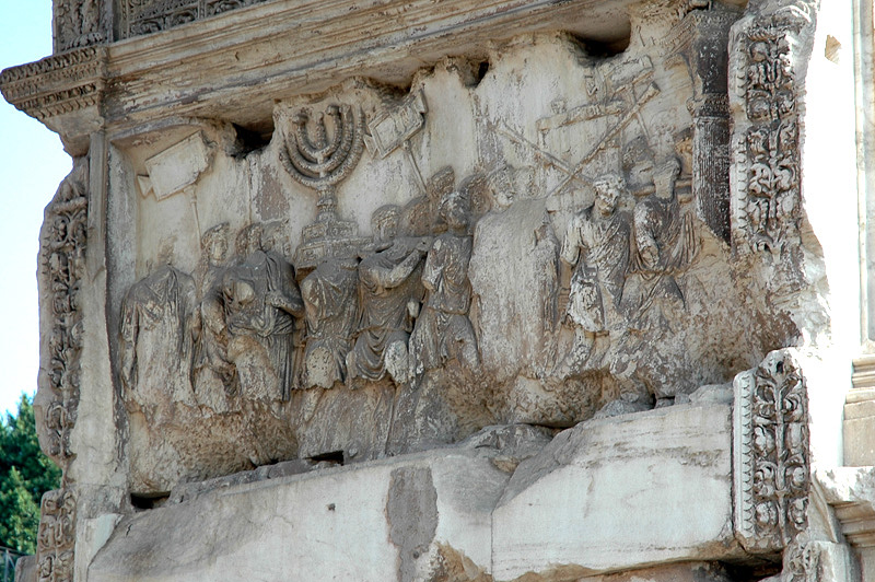 Arch of Titus.  This portion depicts booty taken from Judea.  This funded many of Rome's expansive projects.