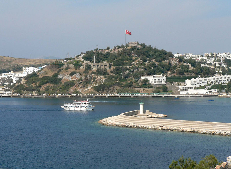 Ship entering Bodrum harbor below the castle