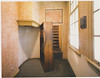 The revolving bookcase leads to a staircase and the bare rooms where they hid.