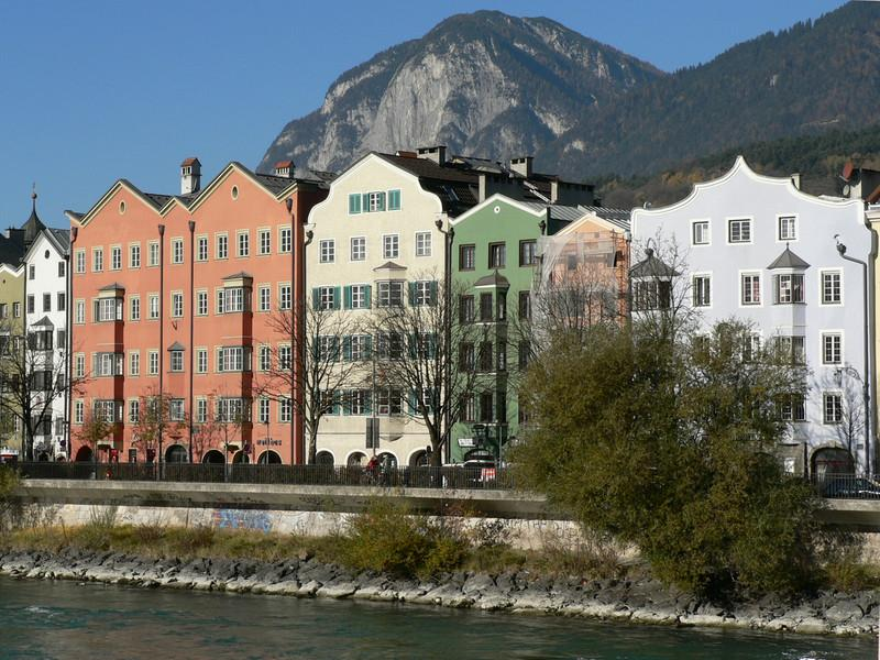 Pretty pastel buildings across the Inn river