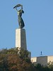 This is the Hungarian Statue of Liberty, a woman holding aloft the olive branch of peace above the city