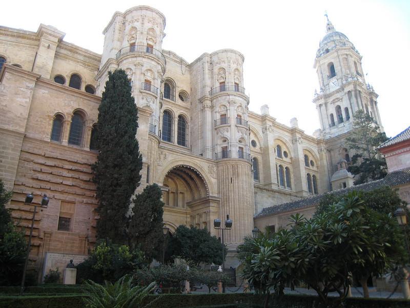 Ancient buildings and lush vegetation = Malaga