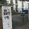The entrance to the recording studio across the crosswalk from the Abbey Road crosswalk.  It is covered in grafitti usually Beatles-related, but not all.