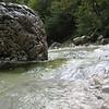 Boulder, rushing water