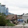 Skyscrapers, turn of the century architecture and primitive-looking bombed house in one scene. - Sarajevo, Bosnia y Herzegovina