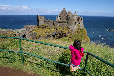 Dunluce Castle, a 16th century castle famous for perching on the high cliff and parts of it fallen into the coean one fateful night in 1639.