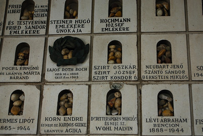Visitors are supposed to bring pebbles from other cemeteries to help the dearly departed RIP-Jewish Synagogue Budapest, Hungary