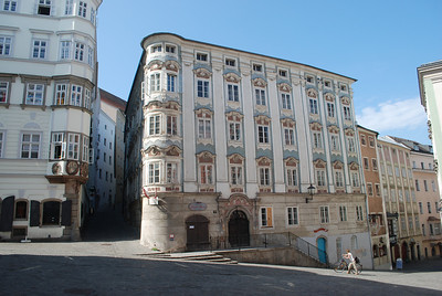Nice building and the alley to the castle. Linz, Austria.