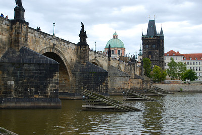 Wooden ramps are there to protect the Charles Bridge from debris and icebergs. Prague, Czech Republic