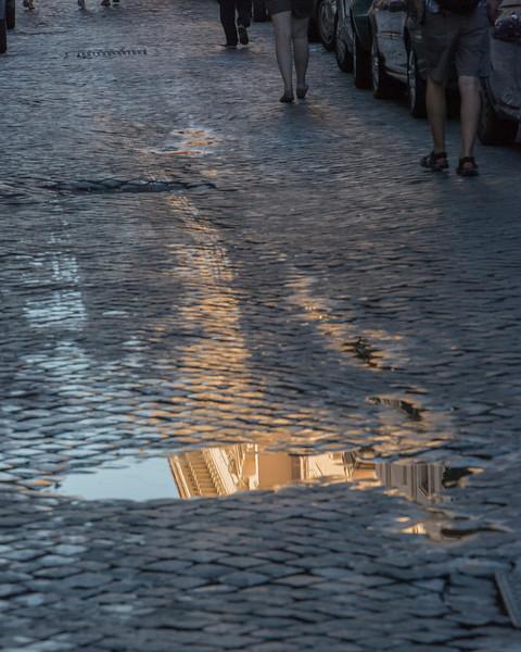 Pretty reflection seen on a Roman cobblestone street.