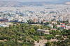 A wide view of Athens, Greece with the Temple of Hephaestus in the foreground.