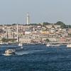 "Old Istanbul, <a href=""http://en.wikipedia.org/wiki/the low grey Galata_Bridge"" target=""_blank"">Galata Bridge</a>, and <a href=""http://en.wikipedia.org/wiki/S%C3%BCleymaniye_Mosque"" target=""_blank""> the Süleymaniye Mosque</a>."