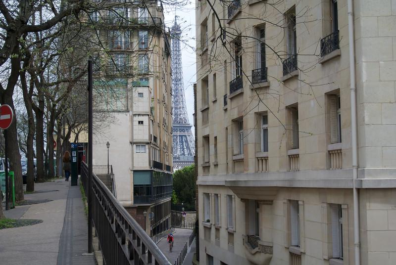 Paris. Tiny cyclist, famous backdrop