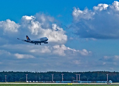 A 747-800 landing while we await to depart Frankfort.