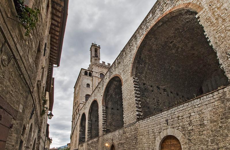The four arches that support the Piazza della Signoria. The Palazzo dei Consoli rises into the sky.