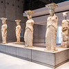 "Acropolis Museum - the Caryatids; the rear right Caryatid was damaged in 1827 by a Turkish cannonbal during the Greek struggle for independence <br> <a href=""https://en.wikipedia.org/wiki/Greek_War_of_Independence"" target=""_blank"">Greek War of Independence</a>"