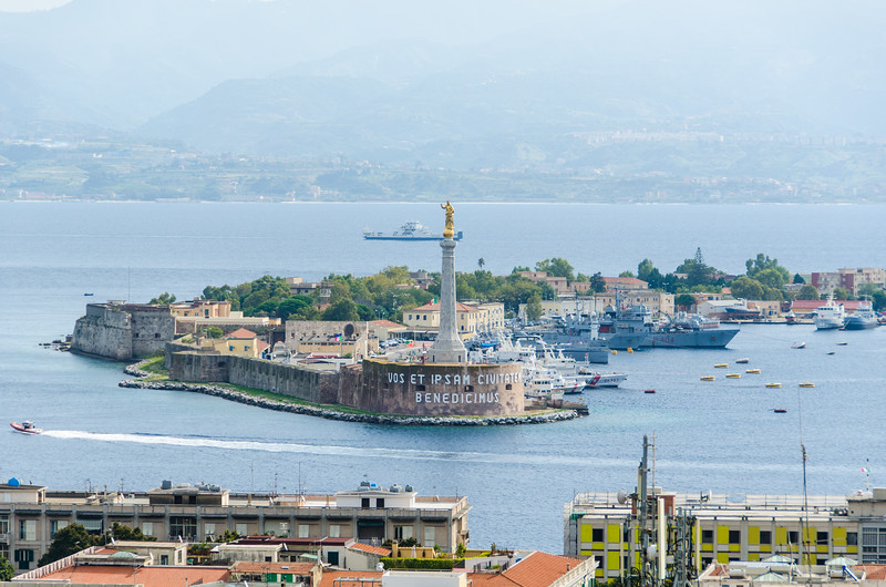 "Messina harbour and the Golden Madonna <br> <a href=""https://en.wikipedia.org/wiki/Messina"" target=""_blank"">Messina</a>"