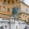 """<br> <a href=""""https://en.wikipedia.org/wiki/Fontana_della_Pigna"""" target=""""_blank"""">Pine cone fountain</a> in the Cortile della Pigna"""