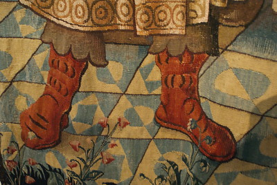 Boots close up - Wall hanging of the liberal arts (arithmatic) ~1520