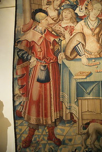Medium shot of man with boots and pouch - Wall hanging of the liberal arts (arithmatic) ~1520