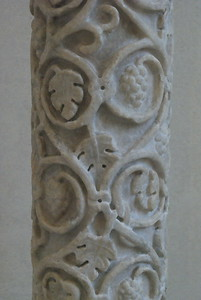 Columns decorated with vine branches and topped with a composite capital