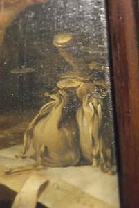 A man weighing gold by Gerard Dou (close-up)